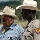 Barry Corbin as Sheriff Buster Watkins and Charles Durning as Murray Blythe in River's End
