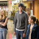Kristen Stewart as Lucy, Adam Brody as Carter, and Makenzie Vega as Paige in director Jonathan Kasden's In the Land of Women, a Warner Independent Pictures release. Photo credit: Liane Hentscher  © 2005 Warner Bros. Entertainment Inc.