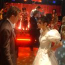 Joey McIntyre as Tony and Mila Kunis as Tina in the scene of Tony 'n' Tina's Wedding.