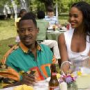 RJ (MARTIN LAWRENCE) and reality-TV-star fiancée Bianca (JOY BRYANT) try and charm his family in a comedy about a self-help guru who is returning to the very place he tried to forget—Welcome Home Roscoe Jenkins. Credit: David Lee