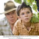 Uncle Henry (Albert Finney, left) teaches his young nephew Max (Freddie Highmore) some important life lessons during the boy's stay at Henry's vineyard in A GOOD YEAR. Photo credit: Rico Torres.
