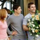 Michelle (Alyson Hannigan) and Jim (Jason Biggs) are not amused by Stifler's (Seann William Scott) antics