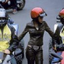 Tina (Meagan Wood, center) gets between two members of the motorcycle racing Biker Boyz: Stuntman (Brendan Fehr) and Primo (Rick Gonzalez)