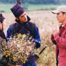 Zhang Ziyi (left), Takeshi Kaneshiro (center) and Zhang Yimou (right) in a shooting location of Sony Pictures Classics' action adventure movie House of Flying Daggers - 2004