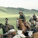Button (Diego Luna, left), Charley Waite (Kevin Costner, center), and Mose Harrison (Abraham Benrubi, right) drive cattle on the open range, the one place where a man can be free.