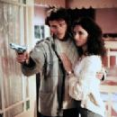 Aidan Quinn and Madeleine Stowe in Stakeout (1987)