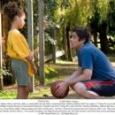 """Harper Burke (Alexis Llewellyn, left), is comforted by her late father's best friend Jerry Sunborne (Benicio Del Toro, right) in """"Things We Lost in the Fire."""" DreamWorks Pictures Presents A Neal Street Production A Susanne Bier Film &#82"""