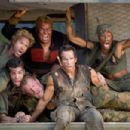 """(Left to right) In the action comedy """"Tropic Thunder,"""" a group of actors shooting a war movie includes Kirk Lazarus (Robert Downey Jr.), an over-the-top Australian-born method actor who has gone to extremes to get into character, novice thesp"""