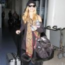 AnnaLynne McCord departing on a flight at LAX airport in Los Angeles, California on January 12, 2015