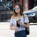 Actress and singer Lucy Hale stops by Starbucks in Los Angeles, California to pick up an iced coffee on August 24, 2016 - 454 x 583