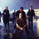 (l to r) Julia Osborne (Connie Nielsen), Tom Hardy (John Travolta), Raymond Dunbar (Brian Van Holt) and Col. Bill Styles (Tim Daly) during a tense moment