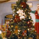 """Will Ferrell (left) as """"Buddy"""" and Zooey Deschanel (right) as """"Jovie"""" in New Line Cinema's upcoming film Elf."""