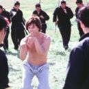 The Chosen One (Steve Oedekerk) enjoys making funny faces and weird hand movements when fighting a deadly team of assassins in 20th Century Fox's Kung Pow!: Enter The Fist - 2002