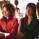 Dania Ramirez as Alex (left), Kerry Washington as Fatima