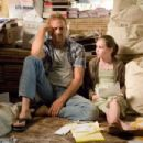 Kevin Costner and Madeline Carroll in SWING VOTE.