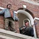 LUIS GUZMAN as a desperate guy out on a ledge and JIM CARREY as Carl in Warner Bros. Pictures' and Village Roadshow's comedy 'Yes Man,' distributed by Warner Bros. Pictures. Photo by Melissa Moseley