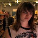 Barb (Nicki Clyne) shopping while Earl (Peter Outerbridge) approaches. - 454 x 230