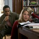 Eugene Byrd as Terell Lessor and Ali Larter as Olivia Averill in Confess.