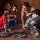 (l to r) Jonah Bobo, Kristen Stewart, Dax Shepard and Josh Hutcherson star in Columbia Pictures' sci-fi adventure Zathura. Photo Credit: Merrick Morton