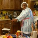 Madea (Tyler Perry, center) with Lisa (Rochelle Aytes, left)