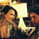 Claudette Mink ('Judy,' left) and Gerard Butler ('Neil Randall,' right) star in Lionsgate Home Entertainment's Butterfly on a Wheel.
