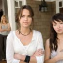 (Left to right) Their father's new fiancee, Rachel (Elizabeth Banks) arouses the suspicions of his daughters Alex (Arielle Kebbel) and Anna (Emily Browning) in 'The Uninvited.' Photo Credit: Kimberley French. Copyright © 2008 DreamWorks LLC an