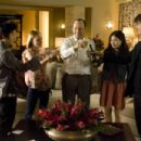 In Columbia Pictures' 21, the M.I.T. blackjack team - a group of students that has figured out how to take Vegas for millions - toasts its success.  Left to right: Choi (Aaron Yoo), Jill Taylor (Kate Bosworth), Micky Rosa (Kevin Spacey), Kianna (Liz