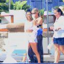 Kourtney Kardashian in Denim Shorts at a pool bar in Cabo