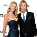 Susan Holmes and musician Duff McKagan attend the 24th Annual Elton John AIDS Foundation's Oscar Viewing Party at The City of West Hollywood Park on February 28, 2016 in West Hollywood, California.