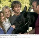 The McLaughlin family -- (from left) Katy (Alison Lohman), Nell (Maria Bello), Howard (Ryan Kwanten) and Tom (Tim McGraw) -- welcome the newest member of the clan: a mustang named Flicka. Photo Credit: Stephen Vaughan. © 2006 Twentieth Century Fox.