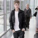 Justin Bieber Touches Down in the UK