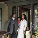 From left: Chris Rock and Gina Torres in I THINK I LOVE MY WIFE. Photo Credit: Phil Caruso