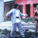 The Chosen One (Steve Oedekerk) admires his martial arts handiwork on his latest opponent in 20th Century Fox's Kung Pow!: Enter The Fist - 2002