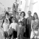 July 29th, 1963 - The Rt Hon Sir David Ormsby-Gore KCMG went aboard the Queen Mary on her arrival today at Southhampton with his children Julian (22, dark glasses), Jane (20) and Victoria (16) to meet his wife Lady Ormsby-Gore, daughter Alice (11, with co - 454 x 392