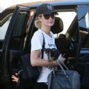Paris Hilton with her little dog arrives for a dentist appointment in LA