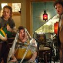 Saul Silver (James Franco, left), Red (Danny McBride, center), and Dale Denton (Seth Rogen, right) run for their lives in Columbia Pictures' action-comedy Pineapple Express. © 2008 Columbia Pictures Industries, Inc.