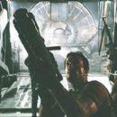 Jayne (Adam Baldwin) and Captain Mal Reynolds (Nathan Fillion).