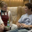 "Sunny Mabrey as ""Tiffany"" and Nathan Phillips as ""Sean Jones"" in New Line Cinema's intense action feature SNAKES ON A PLANE. Photo Credit: ©2005 James Dittiger/New Line Productions - 454 x 302"