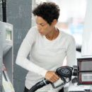 Nicole Murphy stops to refuel while out and about in Brentwood, California on August 7, 2014