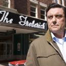"IAN McSHANE as Paul Griffen in Warner Bros. Pictures' and Legendary Pictures' inspirational drama, ""We Are Marshall,"" distributed by Warner Bros. Pictures. Photo by Frank Masi"