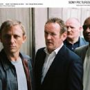 Left: Daniel Craig as XXXX; Center: Colm Meaney as Gene; Right: George Harris as Morty.