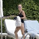 Caroline Wozniacki – In black swimsuit poolside in Portofino - 454 x 582