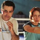 Adam Carolla as Jerry Ferro and Heather Juergensen as Lindsay Pratt in The Hammer. - 396 x 257
