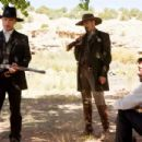 """Marshall Virgil Cole (ED HARRIS, left) and Deputy Everett Hitch (VIGGO MORTENSEN, center) stand guard over their prisoner, Randall Bragg (JEREMY IRONS), in New Line Cinema's Western """"Appaloosa."""" The film is distributed by Warner Bros. Pi"""