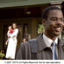 Chris Rock and Gina Torres (background) in I THINK I LOVE MY WIFE. Photo Credit: Phil Caruso