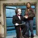"""Brenda Meeks (Regina Hall) makes friends with Jigsaw, and spoofs """"SAW"""", in Scary Movie 4."""