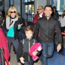 Kelly Ripa and Mark Consuelos depart from LAX airport with their youngest son Joaquin Consuelos - February 26, 2011 - 454 x 435