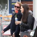 The 'Home Alone' star holds hands with a brunette in Pari
