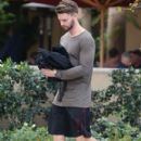Patrick Schwarzenegger out for lunch with a friend at the Bouchon restaurant in Beverly Hills, California on December 17, 2014 - 404 x 594