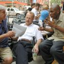 "L-r: Director Richard Donner, Bruce Willis and Mos Def on the set of Alcon Entertainment and Millennium Films' action thriller ""16 Blocks,"" also starring David Morse and distributed by Warner Bros. Pictures. Photo by Barry Wetcher"